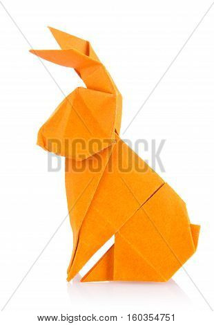 Easter bunny of orange origami. Isolated on white background