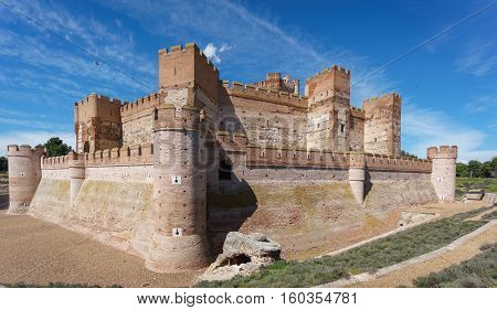 Ultra wide angle view of Castillo de la Mota in Medina del Campo with deep blue sky, Castille, Spain