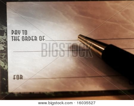 A combination greyscale and colored blank check with a pen
