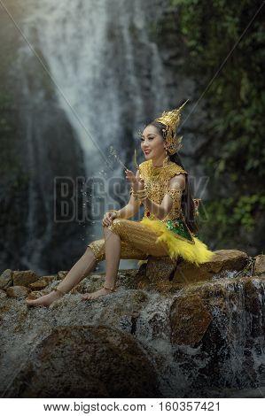 Beautiful Thai girl in Thai traditional costume.