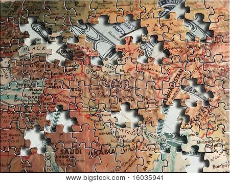 A puzzle map of the middle east sits above US dollars