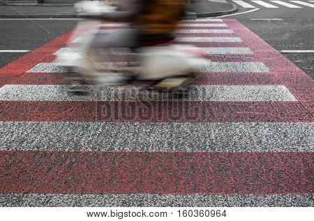 Abstract slow motion man riding moped side view blur movement urban road trip speed concept