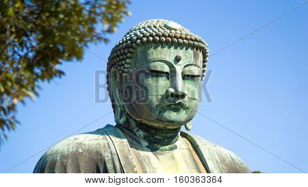 Buddha statue and japan travel concept - Close up face of the Great Buddha daibutsu statue in Kamakura Japan