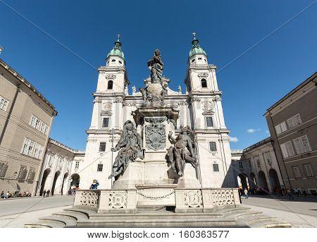 SALZBURG AUSTRIA - APRIL 29 2016: Cathedral of Saints Rupert and Vergilius and Marian column in Domplatz. Salzburg Austria
