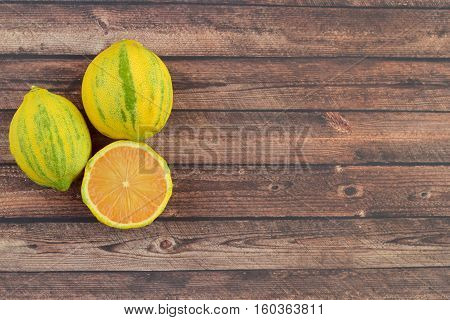 Eureka or pink lemon on wooden background