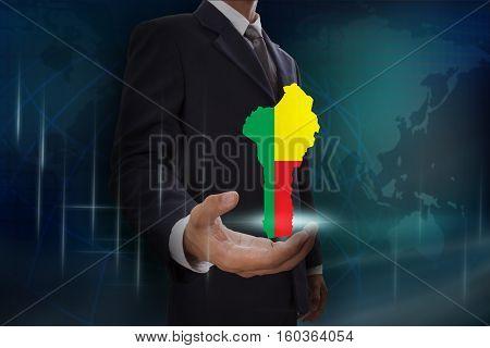 Businessman showing map of Benin on globe background