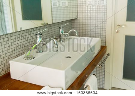 Beautiful modern white washbasin for two persons .