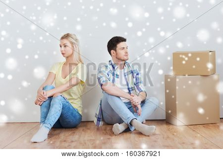 people, relationship difficulties, divorce, conflict and family concept - unhappy couple having argument or break up at home over snow