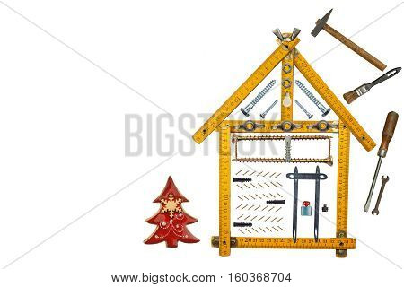 Christmas in a newly built house. Gift on Christmas Eve. Mortgage to build a house. The construction of the building. Isolated on white.