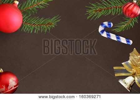Christmas fir branch stick red wavy dull ball bell decoration on a dark background