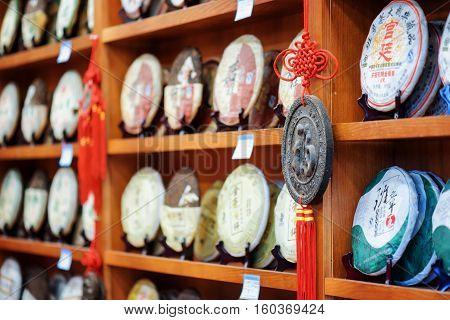 Traditional Chinese Tea On Wooden Shelves At Tea Shop, Lijiang