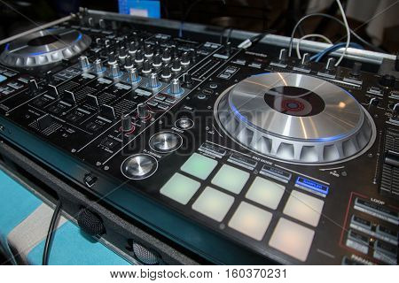 DJ console CD player and mixer in nightclub