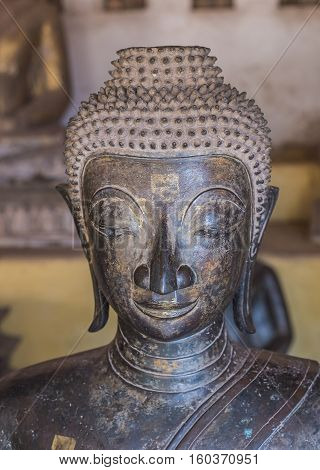 Buddha Head in front of old wall