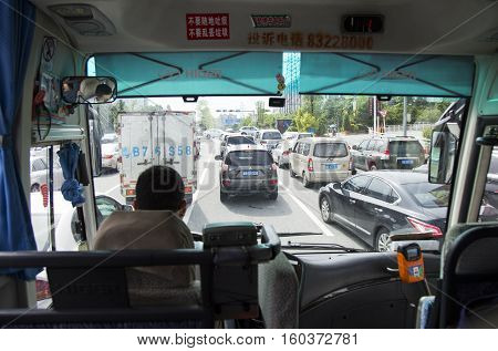 Shenzhen, China - Jun 13, 2016: Traffic jam at rush hour on a busy street of Shenzhen after work. Shenzhen together with Shanghai and Tianjin are cities that car ownership exceeds 2 millions.