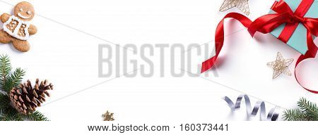 Christmas holiday Decoration element; Christmas border with fir tree branches and Christmas ornament on white background. Flat lay top view