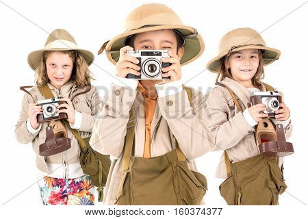 Group of kids having fun with cameras in safari clothes