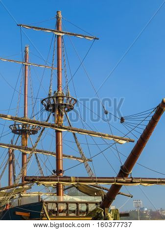 Ancient sailing ship on the blue sky background