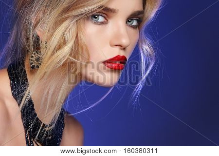 Fashion girl portrait  on a  dark blue background.Accessorys. Long curly hairs