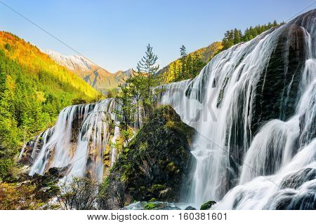 Wonderful View Of The Pearl Shoals Waterfall And Woods At Sunset