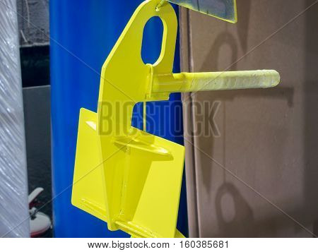 Grip for Sandwich Panel closeup. Grip for installation of sandwich panels. Production of handling removable devices poster