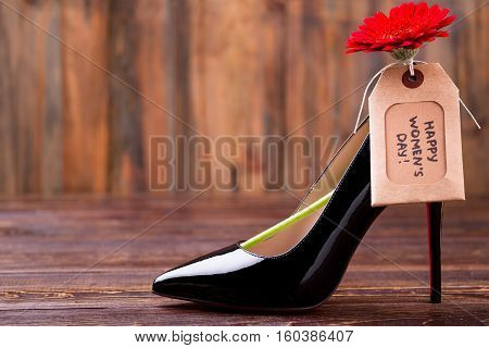 Women's day tag and shoe. Red flower and greeting label. Pamper your lady. Perfect present for stylish girl.