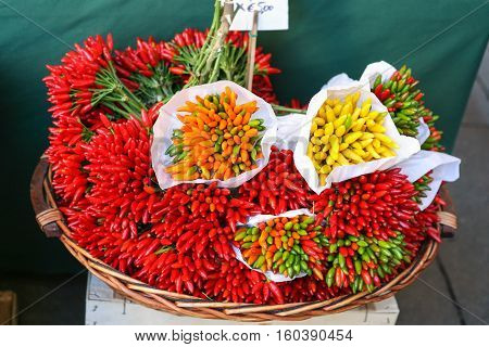 travel to Italy - basket with hot pepper on vegetable market in Italy