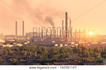 Metallurgy plant at sunset. Steel mill. Heavy industry factory. Steel factory with smog. Pipes with smoke. Metallurgical plant in city. steel iron works. Ecology problems atmospheric pollutants poster