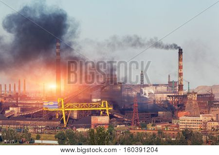 Metallurgy Plant In Ukraine At Sunset. Steel Factory With Smog