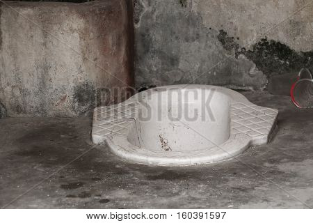 Dirty squat type toilet with copy space for add text