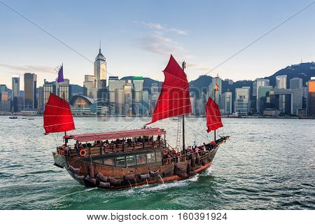 Tourists On Sailing Ship With Red Sails Crosses Victoria Harbor