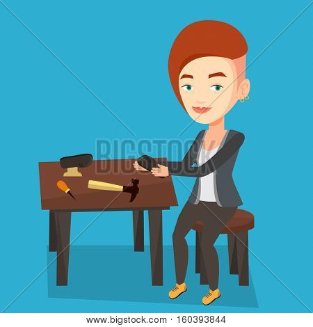 Caucasian shoemaker working with a shoe in workshop. Female shoemaker repairing a shoe in workshop. Young shoemaker making handmade shoes in workshop. Vector flat design illustration. Square layout.