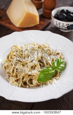 Italian pappardelle pasta with pesto genovese, basil and parmesan cheese