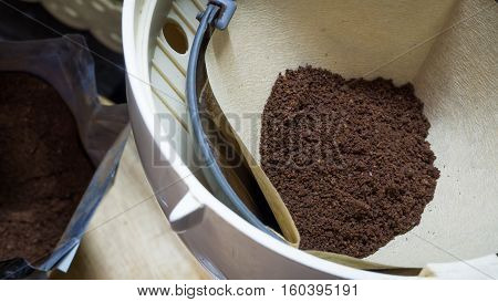 Finely ground coffee powder in the cafe