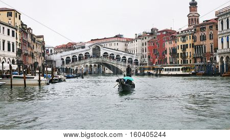 Raghetti Boat And Rialto Bridge In Venice In Rain