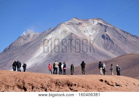 BOLIVIA - AUGUST 29: Unidentified people at Ollague or Ullawi stratovolcano in the Andes on the border between Bolivia and northern Chile on August 29 2016.