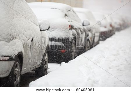 Cars covered with fresh white snow. Outdoor photo
