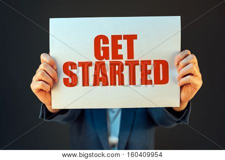 Get started business motivational message held by businesswoman company start up concept