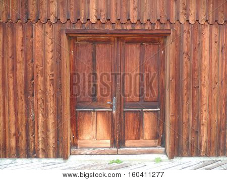 Wooden siding of the building with doors