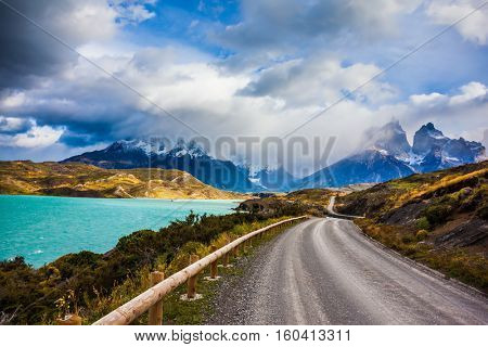 The road around lake Pehoe. Concept of ecotourism. Chile, Patagonia. Torres del Paine National Park - Biosphere Reserve