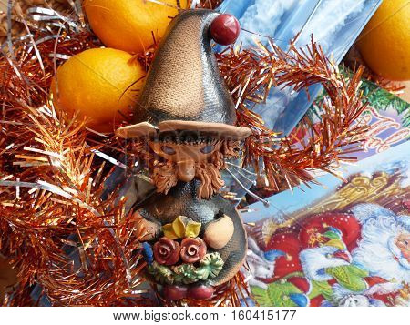 New Year's and Christmas. Gnome, tangerine and Christmas candle. The interior of the New Year.