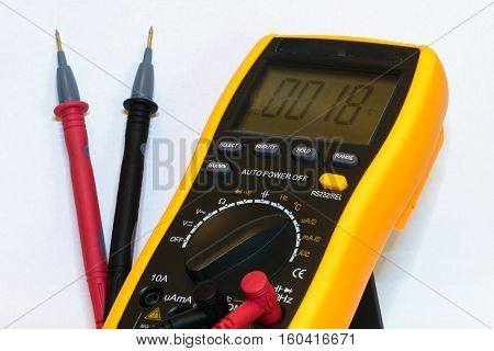 Digital multimeter with test leads connected - isolated on white background
