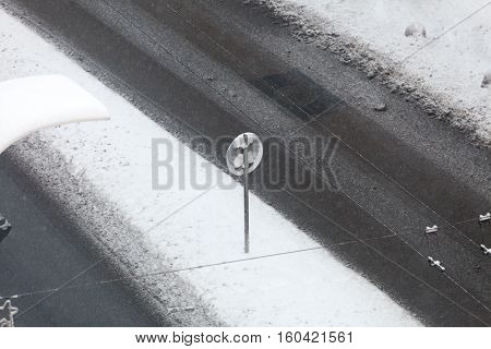 Winter season and seasonal specific. Snow on city road top view