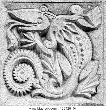 fabulous lizard a retro stone bas-relief on the wall