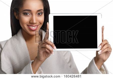 Laughing Young African American Male Holding a Touch Pad Tablet PC on Isolated White Background.