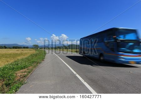 moving bus on the lane blue sky background in Chiang rai Thailand