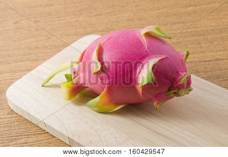 Fresh Fruits Ripe and Sweet Dragon Fruit or Pitaya on A Wooden Cutting Board.