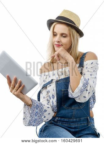 beautiful blond middle-aged woman with tablet computer