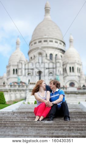 Couple Of Tourists Sitting By The Sacre-coeur In Paris