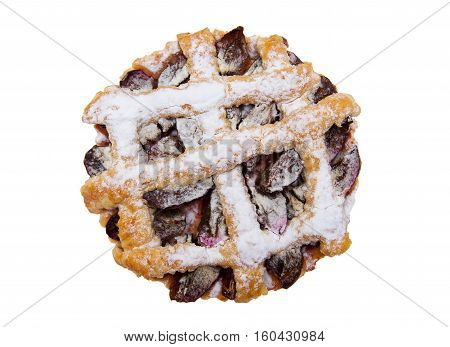 Tart with plums isolated on the white background