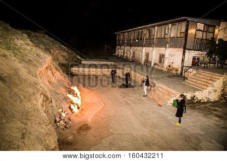 BAKU, AZERBEIJAN- OCT 4, 2016:Tourists at burning mountain in Yanar Dag on Oct 4, 2016, near Baku city. Azerbaijan.